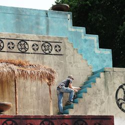 A plastic foam set is painted as The Church of Jesus Christ of Latter-day Saints' production of the fourth season of Book of Mormon videos is filmed near Springville on Monday, July 26, 2021.