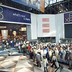 A smaller-than-usual crowd enters the TechXNY PC Expo as the doors open at New York's Javits Convention Center.