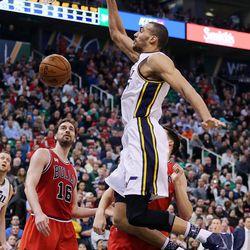 Utah Jazz center Rudy Gobert (27) dunks the ball with Chicago Bulls center Pau Gasol (16) at left during NBA basketball in Salt Lake City, Monday, Feb. 1, 2016.