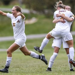 Anna Roberts (0) celebrates alongside her teammates after scoring their third goal of the game in a 5A quarterfinal girls soccer match at Murray Park in Murray on Thursday, Oct. 17, 2019. Mountain View won the match 3-2.