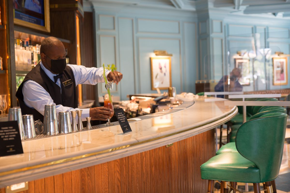 A bartender works at Sadelle's at the Bellagio