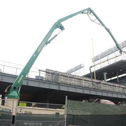 Arm for the concrete transferring equipment maneuvering over to the concrete truck -
