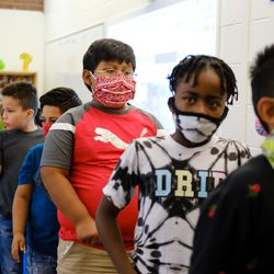 A group of third grade students line up to leave their classroom. Virginia Court Elementary School serves just over 300 students.