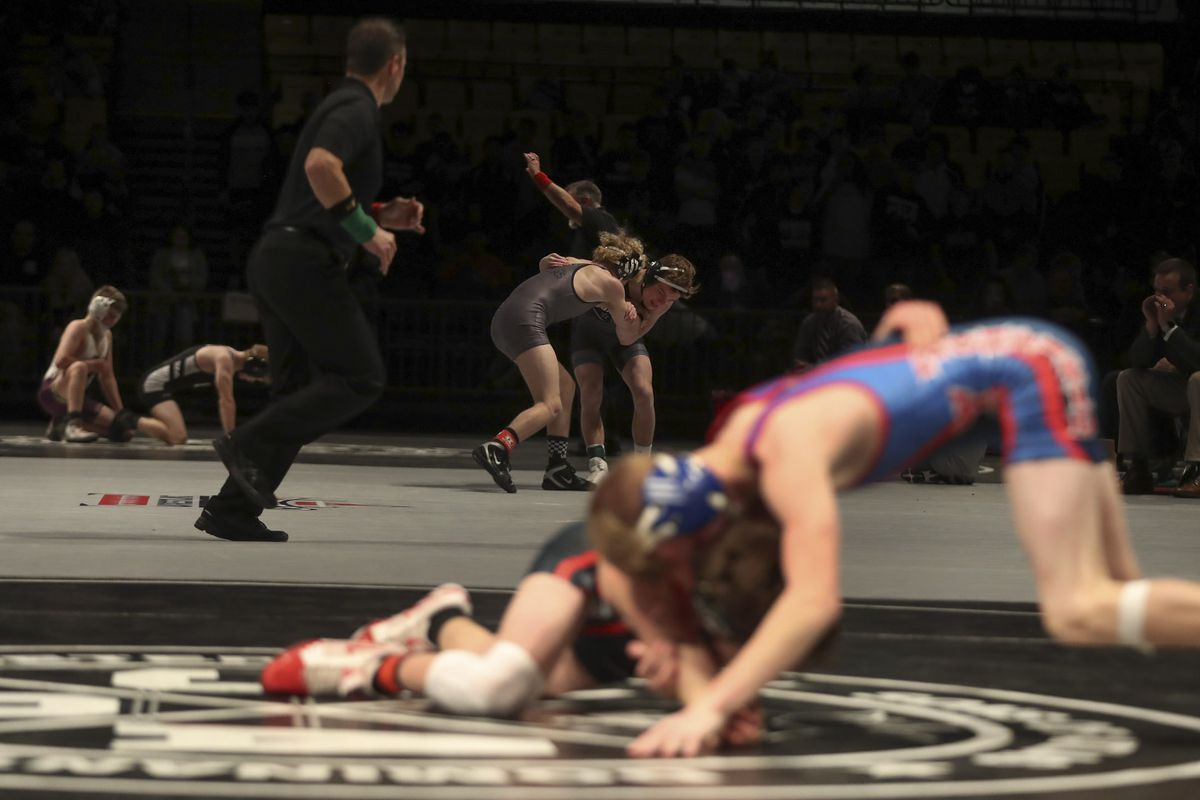 Action on three mats during the Utah All-Star Dual wrestling matches at UVU's UCCU Center in Orem on Tuesday, Jan. 14, 2020.