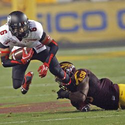 Utah Utes wide receiver Dres Anderson (6) is tackled by Arizona State Sun Devils linebacker Steffon Martin (2) as the Univeristy of Utah and Arizona State University play PAC 12 football Saturday, Sept. 22, 2012, in Tempe, Arizona.