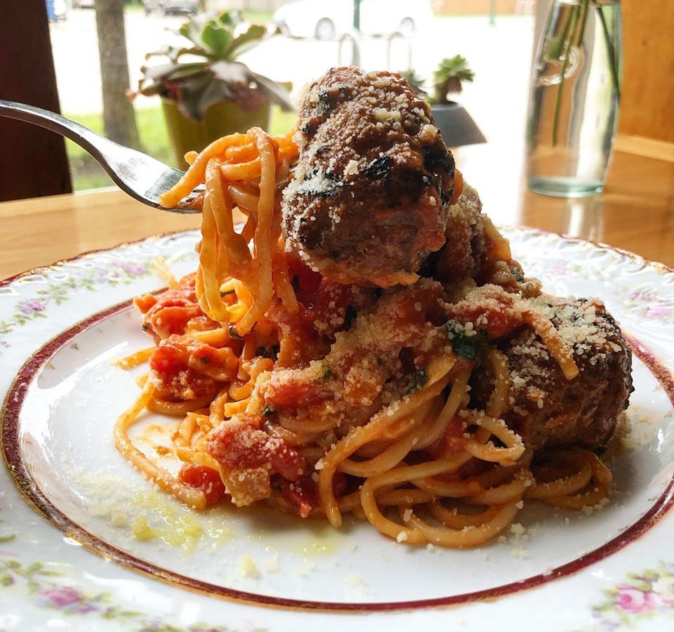 A huge plate of spaghetti with meatballs