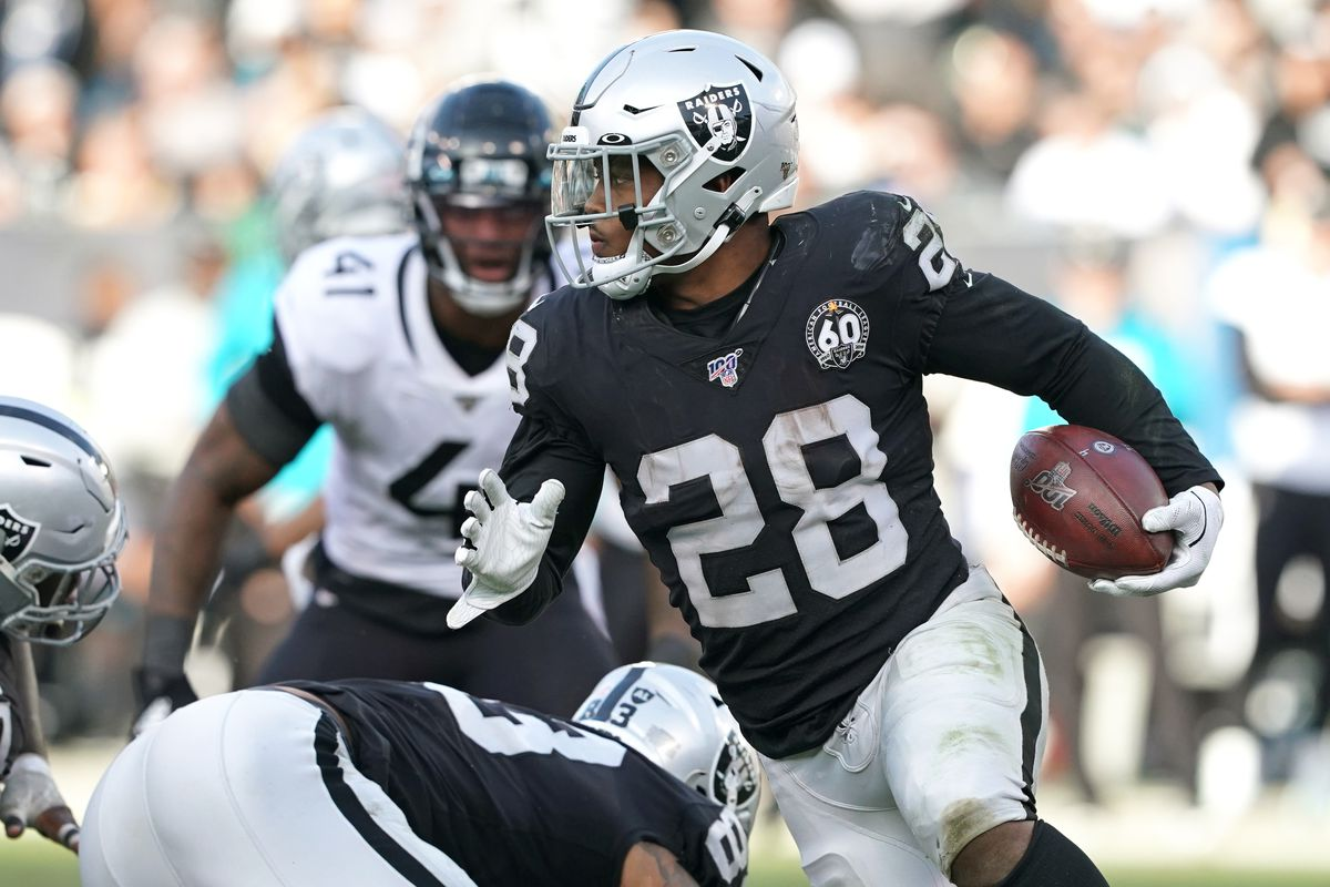 Oakland Raiders running back Josh Jacobs carries the ball during the fourth quarter against the Jacksonville Jaguars at Oakland Coliseum.