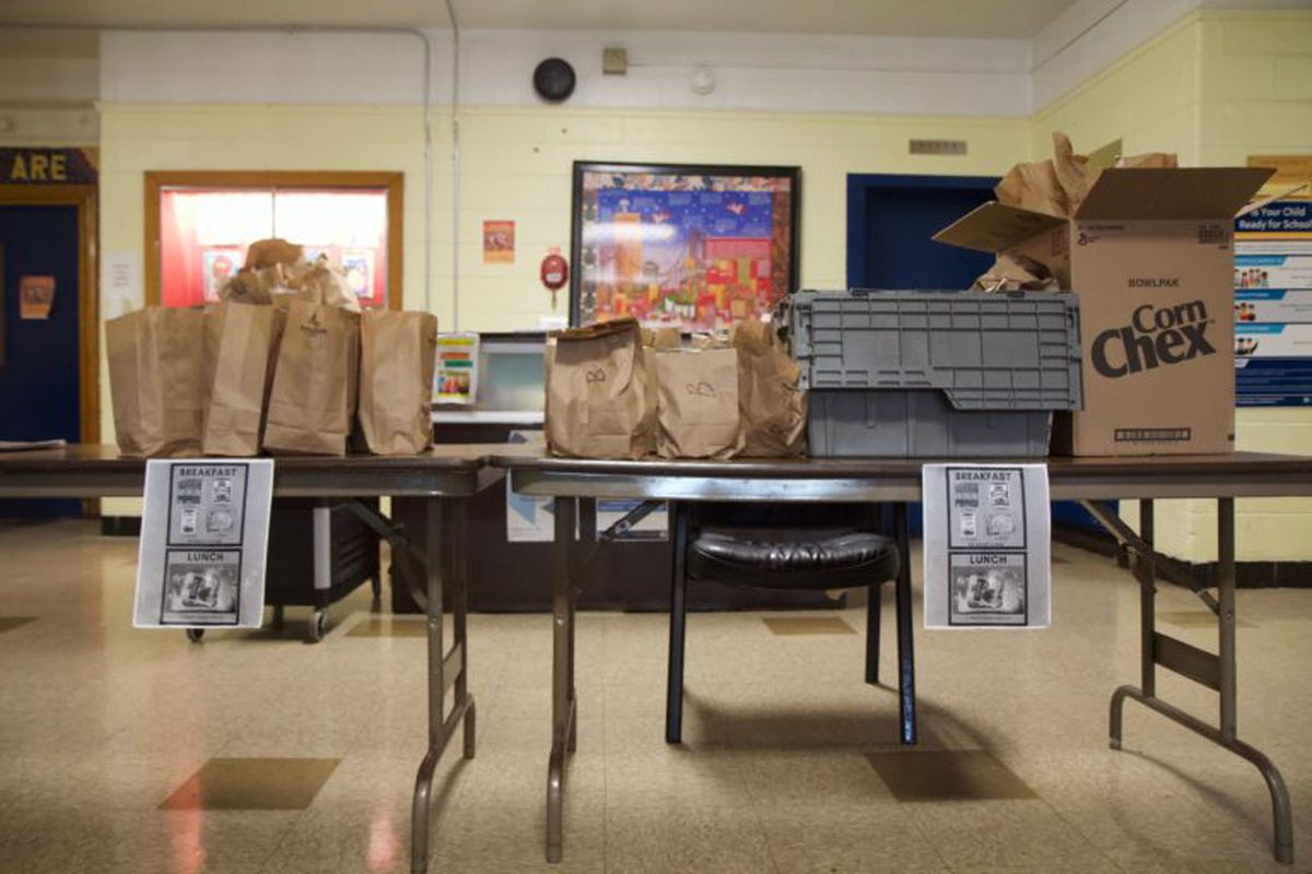 Bagged breakfast and lunches for students at Edward Gideon school during school shutdowns due to the coronavirus.