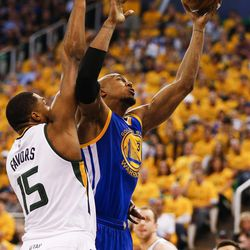 Golden State Warriors forward David West #3 shoots under Utah Jazz forward Derrick Favors #15 during game four of the Western Conference Semifinal at Vivant Smart Home Arena in Salt Lake City on Monday, May 8, 2017.