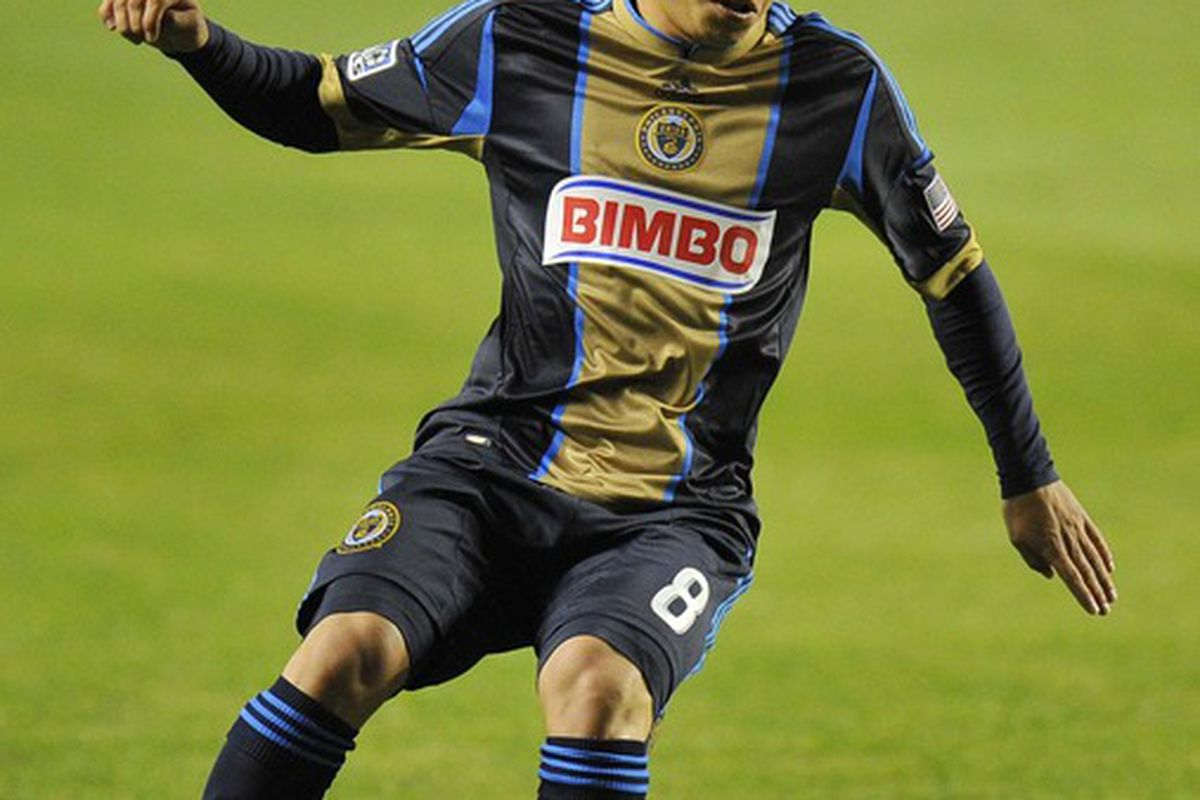 Mar 24, 2012; Bridgeview, IL, USA;  Philadelphia Union midfielder Roger Torres (8) kicks the ball against the Chicago Fire during the first half at Toyota Park.  Mandatory Credit: Mike DiNovo-US PRESSWIRE