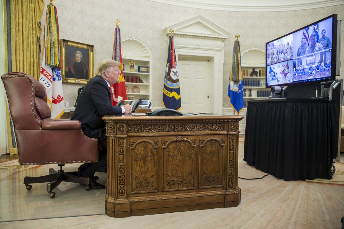 Trump delivers Christmas Day message to troops from Oval Office.