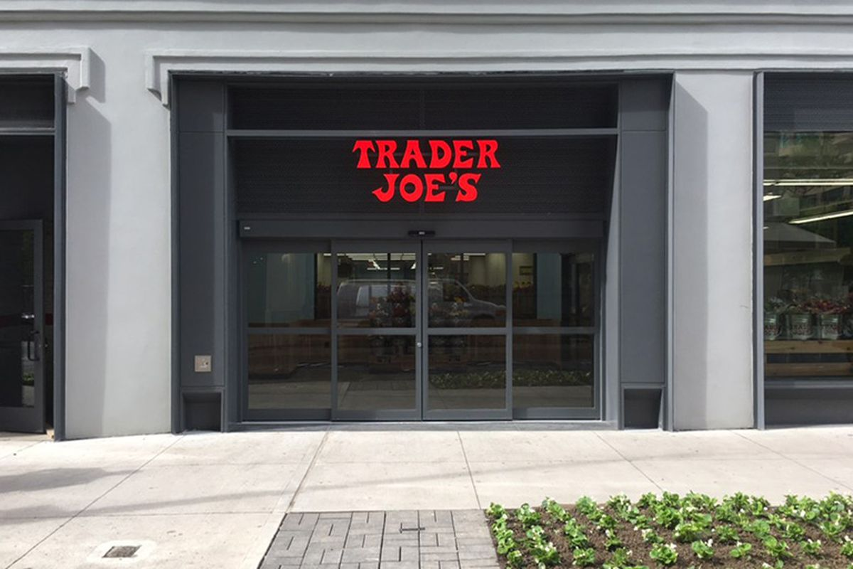 The exterior of a store with the words trader joe's emblazoned in red