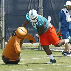 DAVIE, FL - MAY 23: Micajah Reynolds #98 of the Miami Dolphins participates in drills during the rookie minicamp on May 23, 2014 at the Miami Dolphins training facility in Davie, Florida.