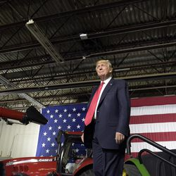 President Donald Trump walks on stage to speaks at Kirkwood Community College, which is recognized by the White House as a major center of agricultural innovation, during a visit to the campus in Cedar Rapids, Iowa, Wednesday, June 21, 2017. This is Trump's first visit to Iowa since the election.