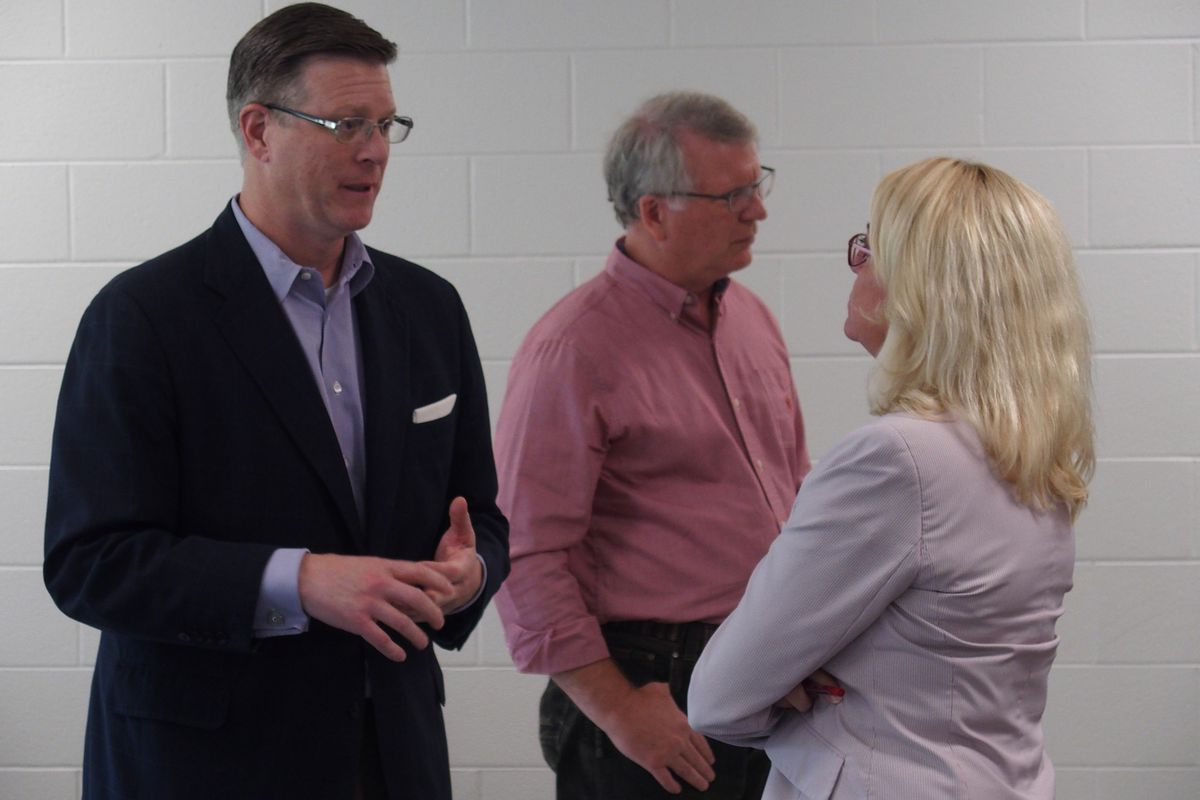 Signal Mountain Mayor Chris Howley speaks with Valerie Speakman, general counsel for Arlington Community Schools, during three days of discussions with leaders of Shelby County's suburban school systems.