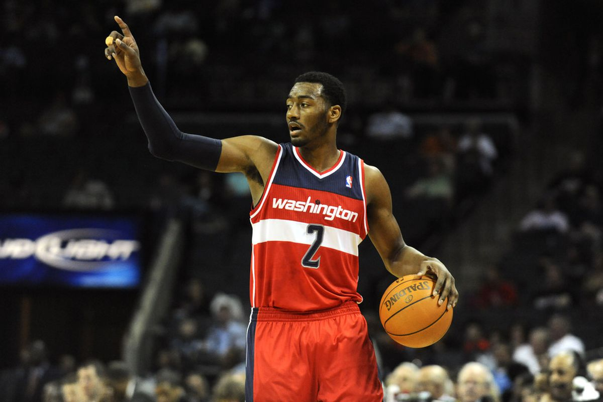 April 9, 2012; Charlotte, NC, USA; Washington Wizards guard John Wall (2) signals to his team during the game against the Charlotte Bobcats  at Time Warner Cable Arena. Mandatory Credit: Sam Sharpe-US PRESSWIRE