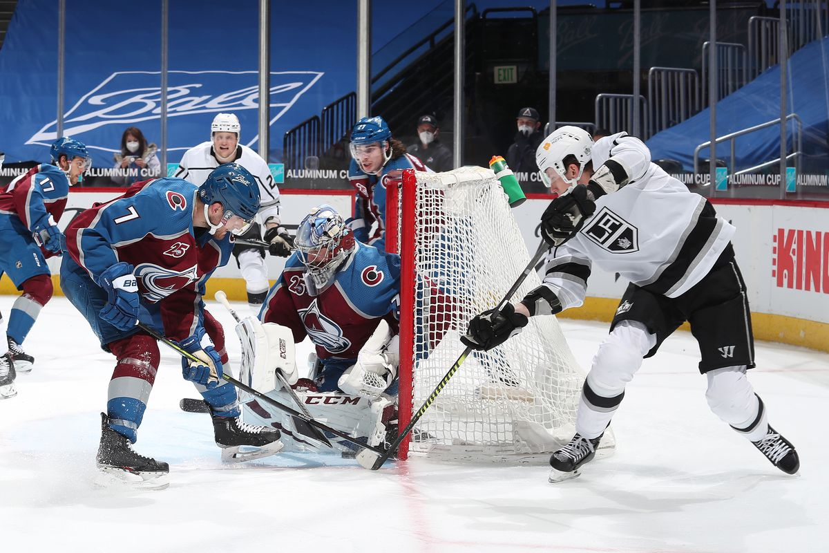 Goaltender Philipp Grubauer #31 of the Colorado Avalanche makes a save against Matt Luff #64 of the Los Angeles Kings next to teammate Devon Toews #7 at Ball Arena on March 12, 2021 in Denver, Colorado.