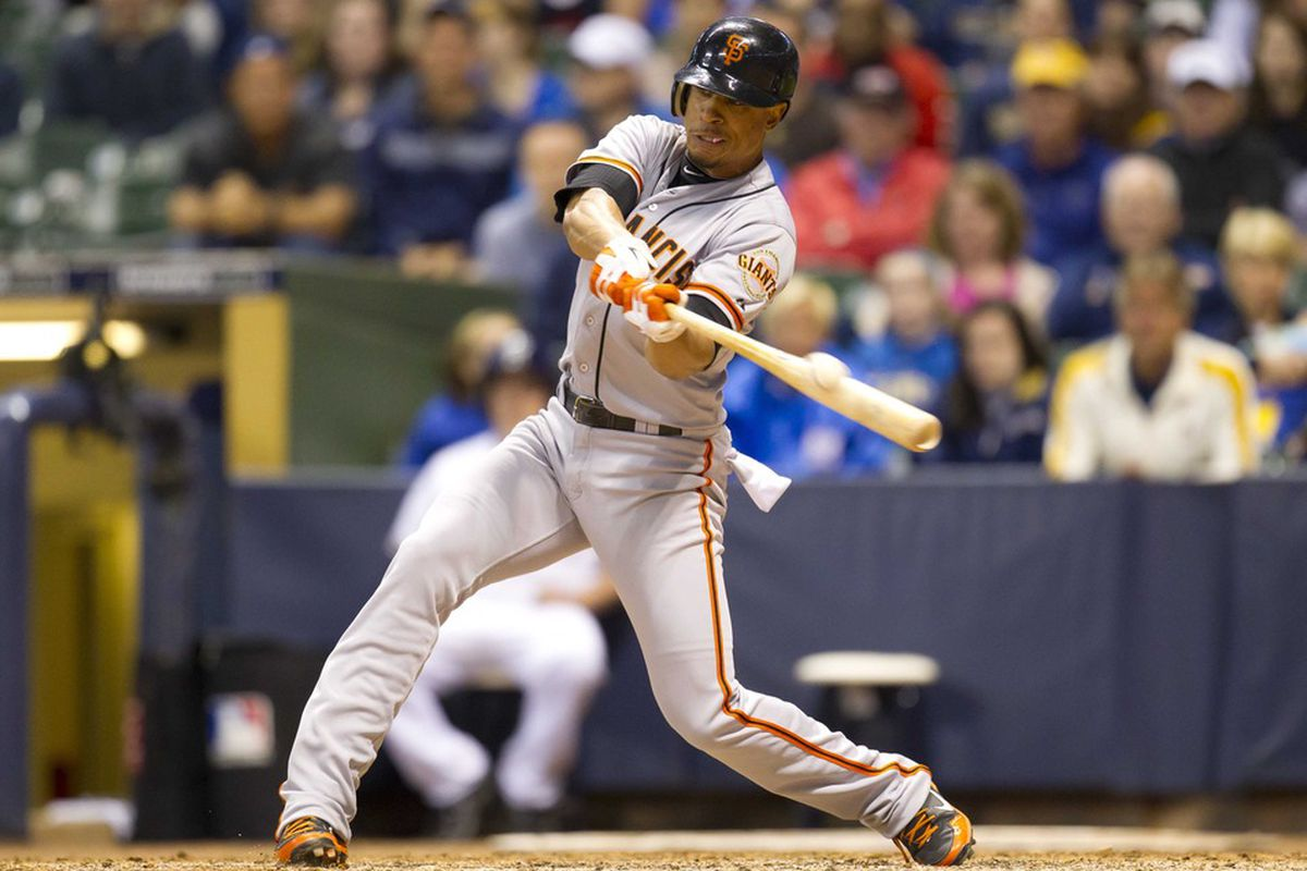 May 21, 2012: Milwaukee, WI, USA;  San Francisco Giants second baseman Emmanuel Burriss (2) bats during the game against the Milwaukee Brewers at Miller Park.  The Giants defeated the Brewers 4-3.  Mandatory Credit: Jeff Hanisch-US PRESSWIRE