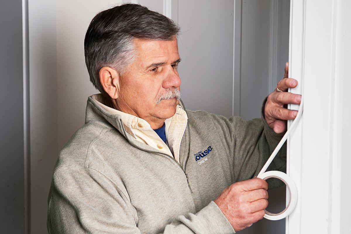 Tom Silva replacing door molding weatherstripping.