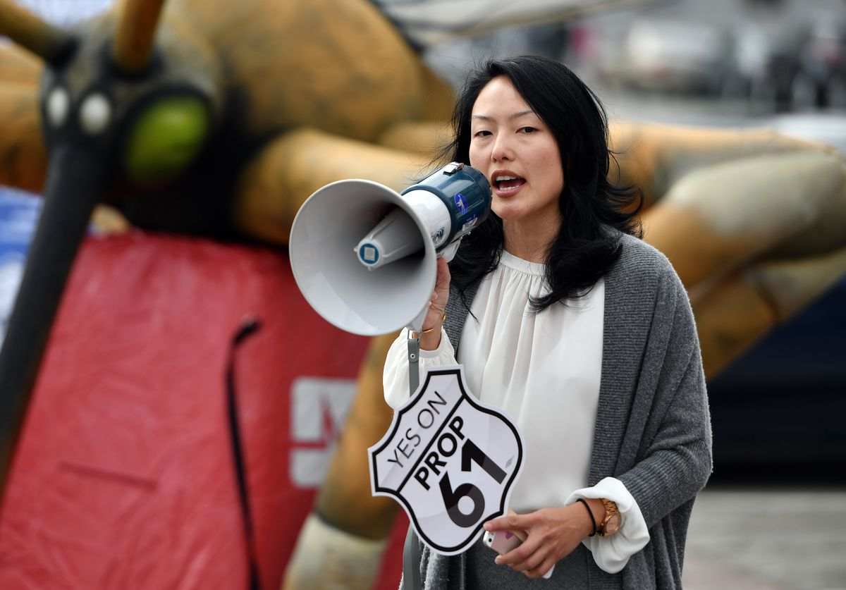 """Jane Kim addresses a crowd during a """"Yes on Prop 61"""" rally outside City Hall in 2016."""