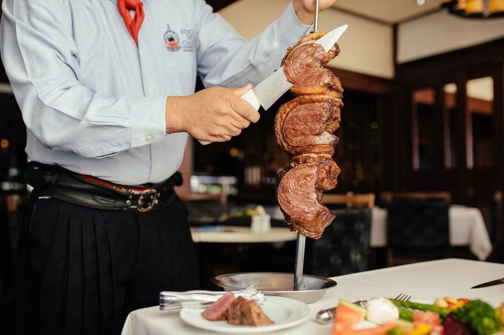 meat getting sliced off a skewer