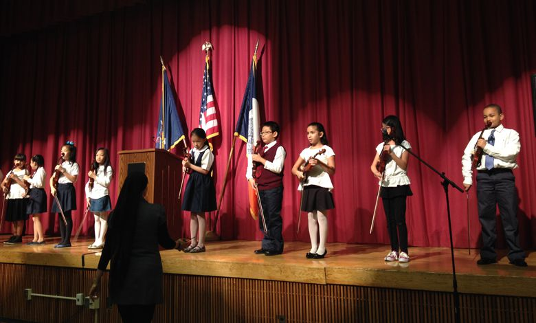 """Before Chancellor Carmen Fariña spoke at P.S. 503 and P.S. 506 in Brooklyn on Oct. 1, 2014, students played songs on the violin, including """"When You Wish Upon A Star."""""""