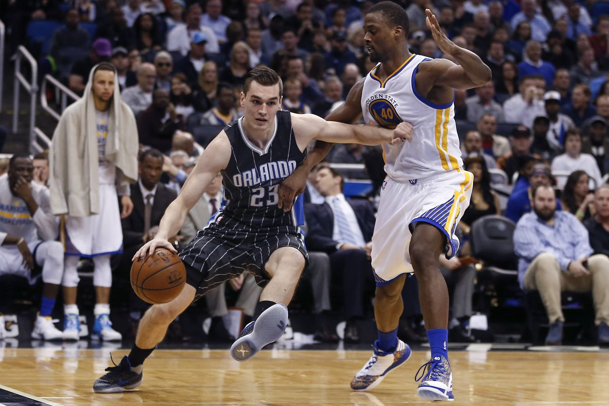 Mario Hezonja drives along the baseline against Harrison Barnes in the Magic's 114-130 loss to the Warriors Thursday.