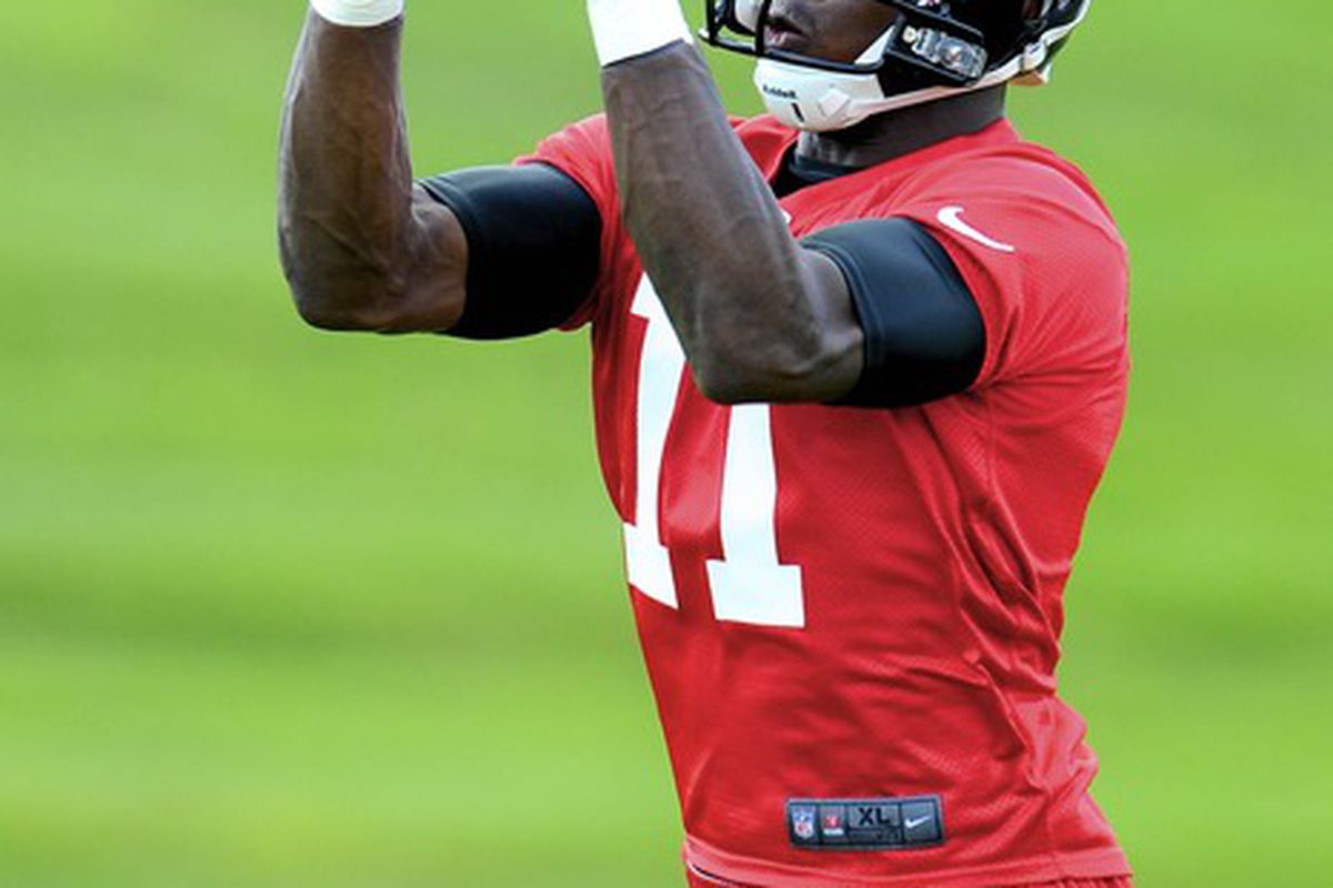 June 6, 2012; Flowery Branch, GA, USA; Atlanta Falcons wide receiver Julio Jones (11) catches a pass on the field during organized team activities at the Falcons training facility. Mandatory Credit: Dale Zanine-US PRESSWIRE