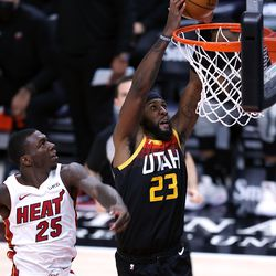 Utah Jazz forward Royce O'Neale (23) goes up for a dunk after being fouled by Miami Heat guard Kendrick Nunn (25) as the Utah Jazz and the Miami Heat play an NBA basketball game at Vivint Smart Home Arena in Salt Lake City on Saturday, Feb. 13, 2021. Utah won 112-94.