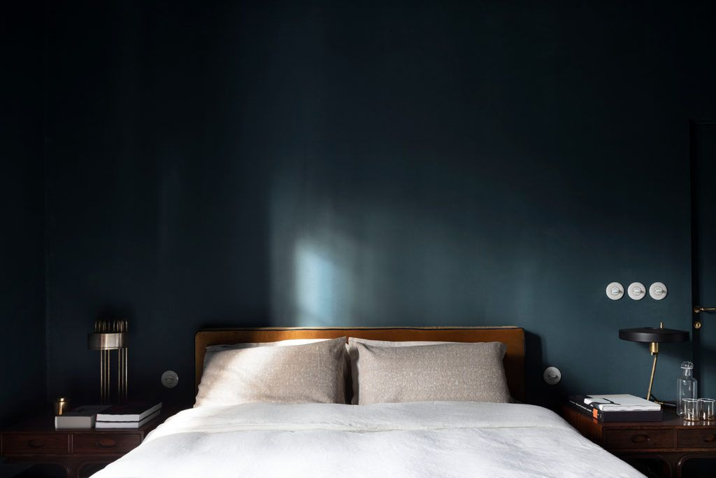 Bed against dark blue wall
