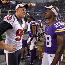 Aug 9, 2013; Minneapolis, MN, USA; Houston Texans defensive end J.J. Watt (99) talks with Minnesota Vikings running back Adrian Peterson (28) following the game at the Metrodome. The Texans defeated the Vikings 27-13.