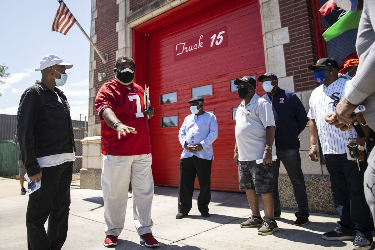 Retired Black Chicago firefighters rally outside Station 45 in Bronzeville on Tuesday.