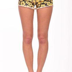 "Floral cut off denim shorts, <a href=""http://shopblush.com/shop/clothes/BLB01933-floral-cut-off-denim-short-yellow#.Uzz1mK1dVi4"">$44</a>"