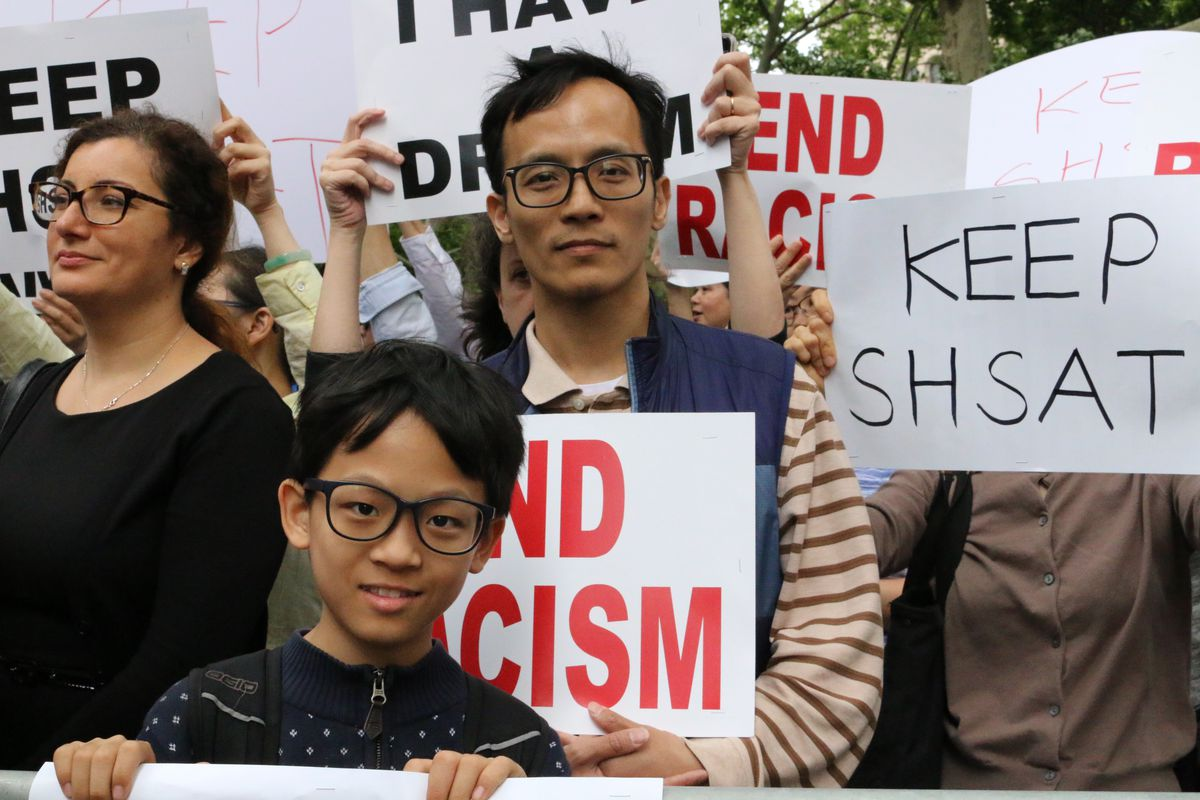 Davis Zong Jr, a sixth-grade student at the selective school New Explorations into Science, Technology and Math, and his father, Davis Zong Sr., attend a rally in 2018 to keep the SHSAT.