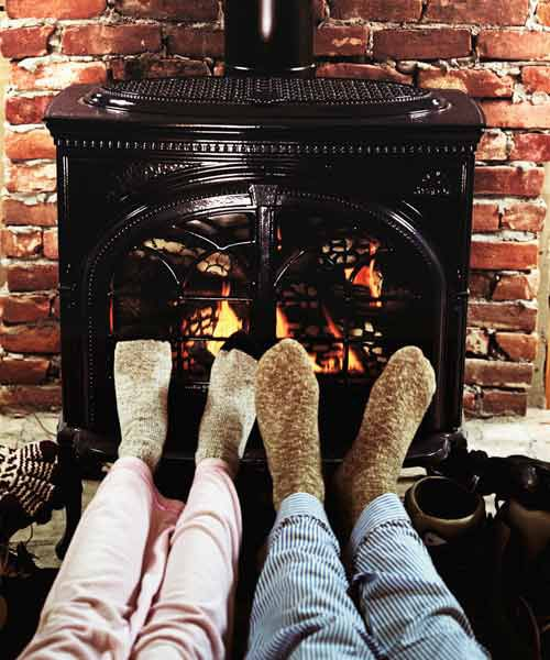 Feet Warming Near Pellet Stove