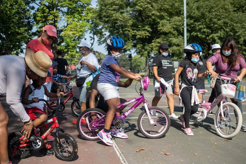 A bicycle giveaway at Union Park on Saturday, Aug. 28, 2021 included free helmets and some instruction in bike safety.
