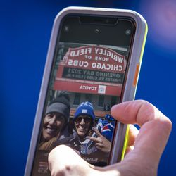 Fans take selfies outside Wrigley Field before the Chicago Cubs Opening Day game against the Pittsburgh Pirates.