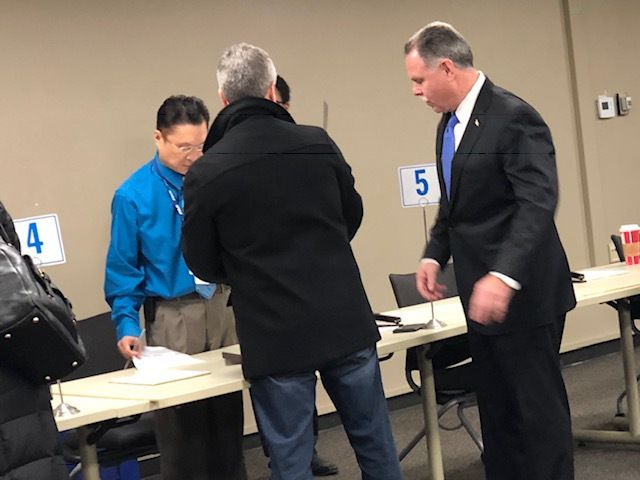 Mayoral candidate Garry McCarthy (right) files roughly 55,000 signatures Monday morning. He said his campaign deleted some 10,000 signatures determined to be invalid.   Fran Spielman/Sun-Times