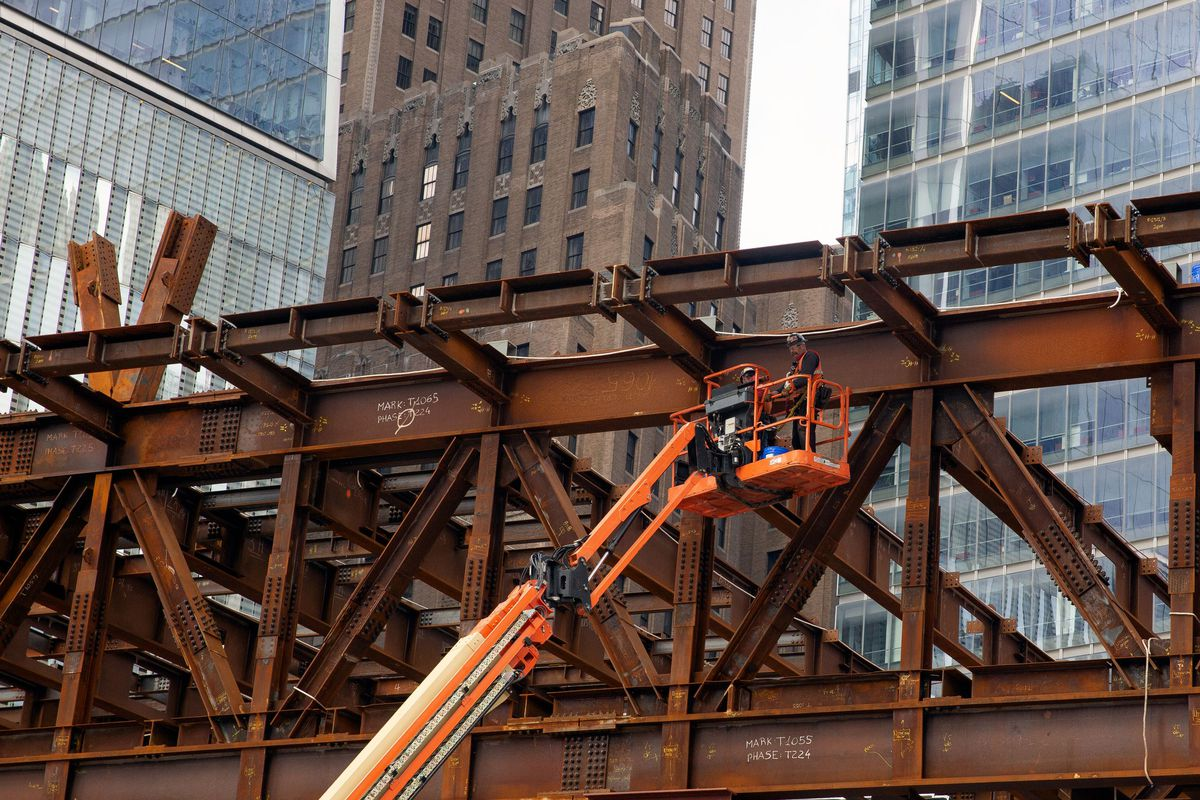 Construction workers continue to erect a structure at the World Trade Center during the coronavirus outbreak.