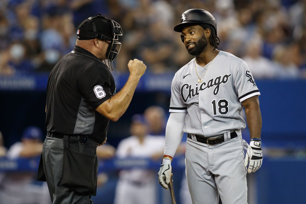 Brian Goodwin of the White Sox looks to umpire Mark Carlson after striking out against the Blue Jays.