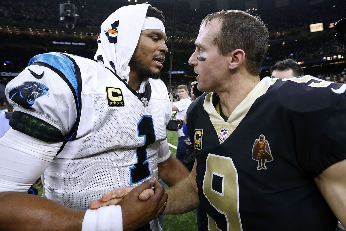 Quarterback Drew Brees of the New Orleans Saints and quarterback Cam Newton of the Carolina Panthers greet after the NFC Wild Card playoff game at the Mercedes-Benz Superdome on January 7, 2018 in New Orleans, Louisiana.