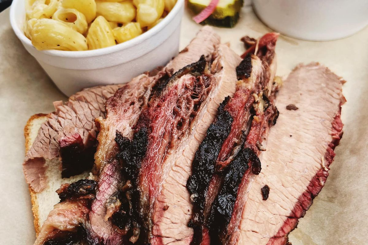 Slices of tender beef brisket paired with mac and cheese and coleslaw from Ford's BBQ, now open in Tucker and Oakhurst-Decatur, Georgia.