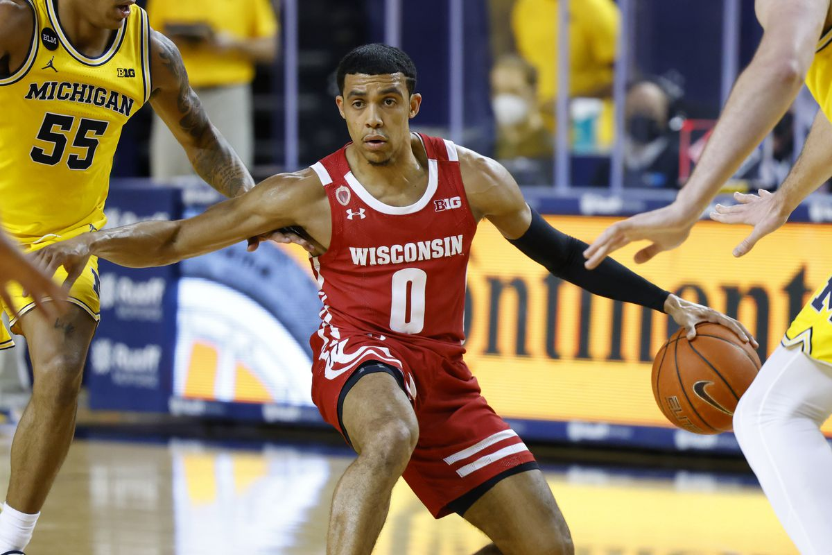 Wisconsin Badgers guard D'Mitrik Trice dribbles against the Michigan Wolverines in the second half at Crisler Center.
