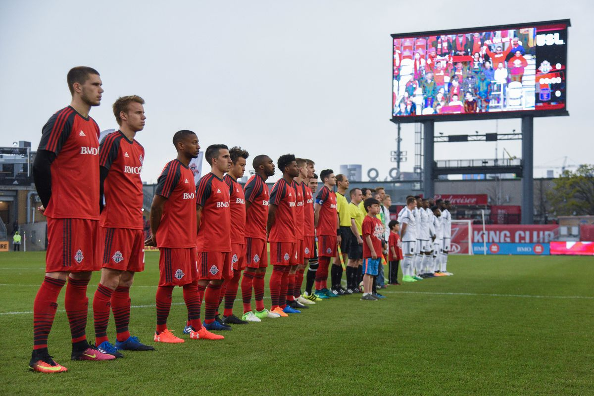 USL Photo - both teams await the start of the match as anthems play