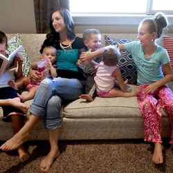 Davis Hyde, left, Hazel, mom Camilla, Will, Hattie and Laryn spend time together after reading scriptures in Syracuse on Thursday, Aug. 1, 2013.