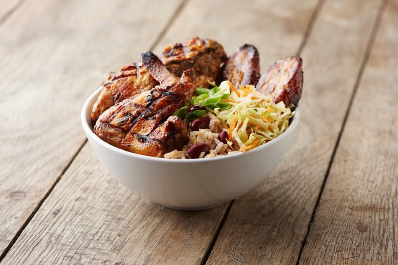 A bowl of jerk chicken over coconut rice