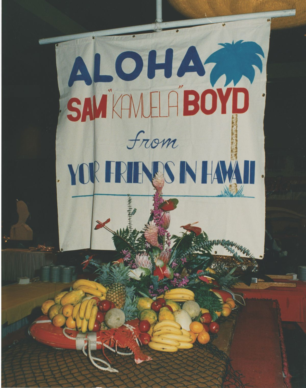 A sign with fruit arranged beneath it.