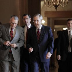 In this July 31, 2011, file photo Senate Minority Leader, Republican Mitch McConnell of Kentucky, walks to the Senate floor for a vote on a solution crafted by Senate Majority Leader Harry Reid, D-Nev, not shown, at the Capitol in Washington.