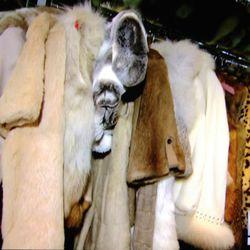 Her many faux fur coats.