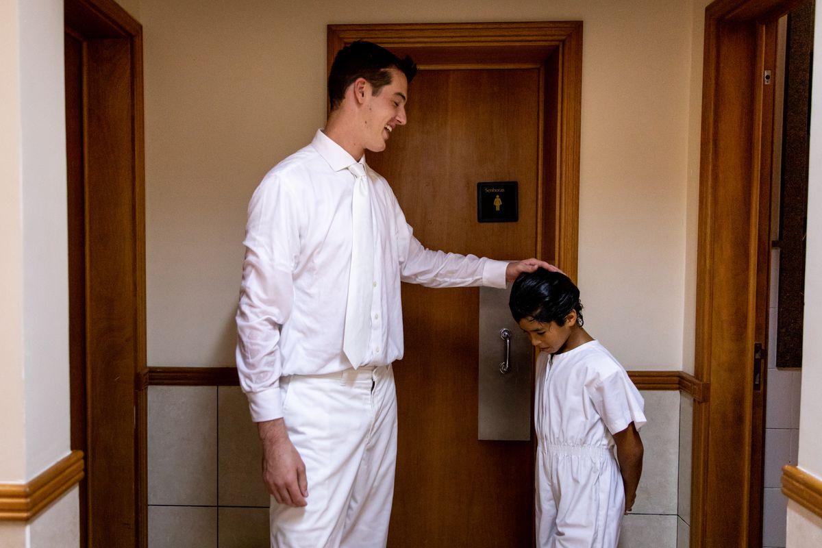 Elder Tanner McKee, a missionary for The Church of Jesus Christ of Latter-day Saints, greets Kelvin Gabriel Franco Dos Santos, 10, after he was baptized in Paranaguá, Brazil, on Saturday, June 1, 2019.